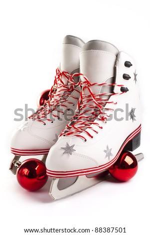 Pair of Christmas Figure Skates on white background - stock photo