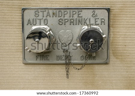 Pair of chrome fire sprinklers - stock photo