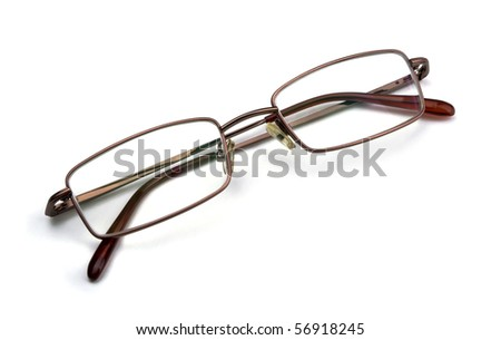 Pair of classic metal-framed glasses isolated on white - stock photo