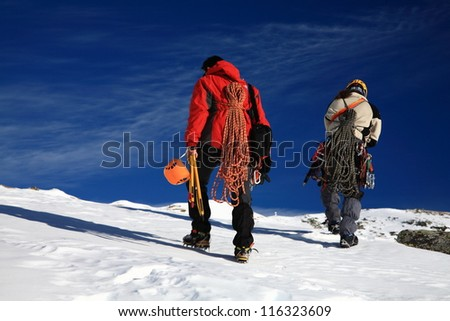Pair of climbers in Retezat mountains, Romania