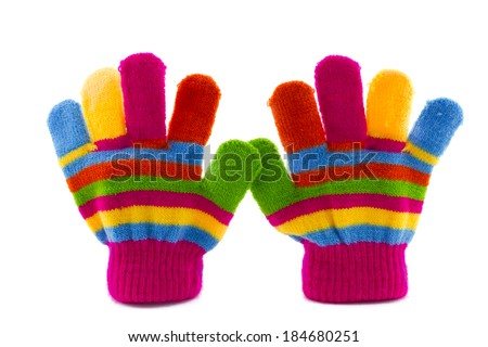 pair of colorful striped cildren's gloves isolated - stock photo