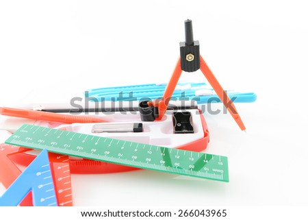 Pair of compasses with rulers - stock photo