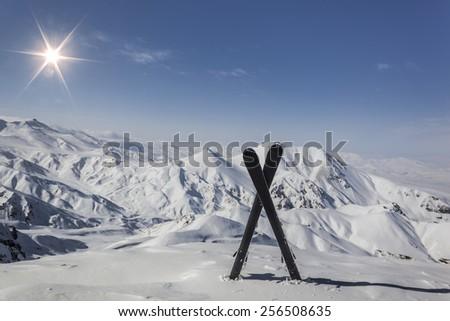 Pair of cross skis in snow - stock photo
