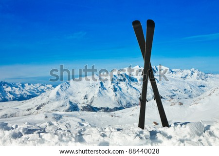 Pair of cross skis in snow. Winter vacations - stock photo