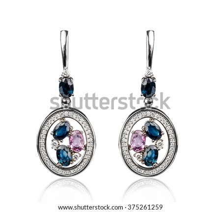 Pair of diamond earrings, isolated on white - stock photo