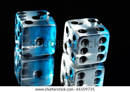 Pair of dice isolated on black background - stock photo
