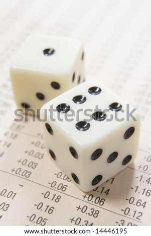 pair of dice on a paper with columns of numbers