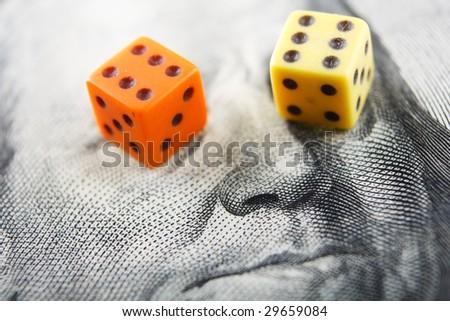 Pair of dice on money - stock photo