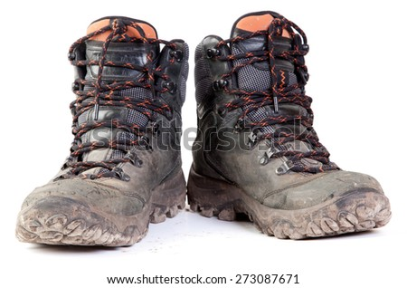 Pair of Dirty Boots Isolated on white background. - stock photo