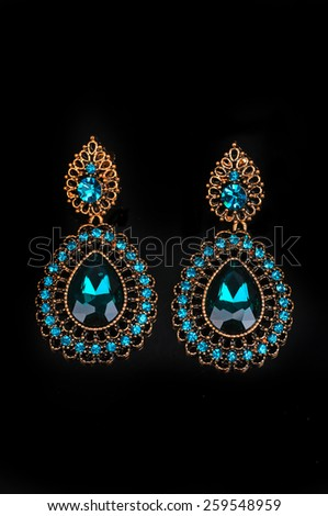 Pair of Earrings with diamonds isolated over black background - stock photo
