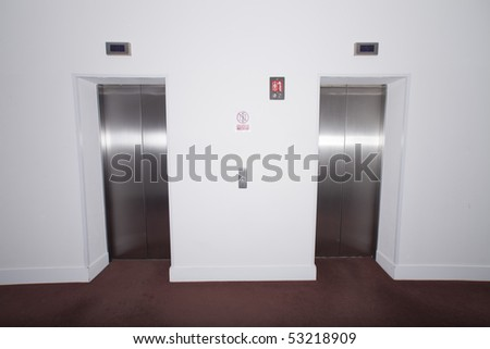 pair of elevators with red carpet - stock photo