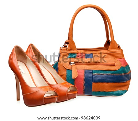 Pair of fashion women shoes and handbag over white - stock photo
