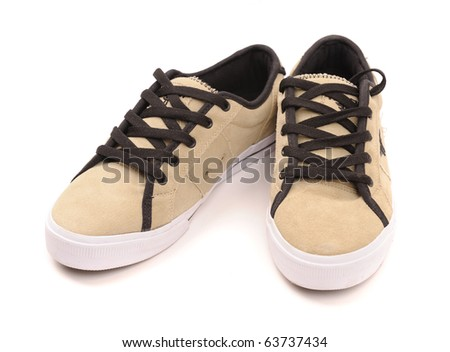 Pair of fashionable sneakers, isolated on white background. - stock photo