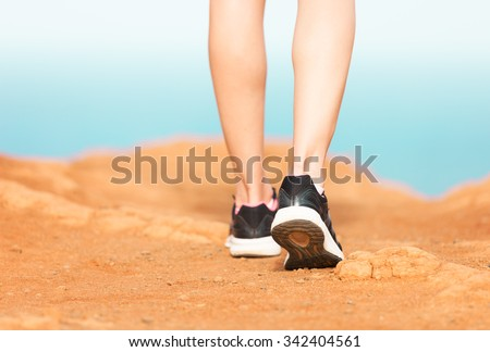 Pair of feet walking. - stock photo