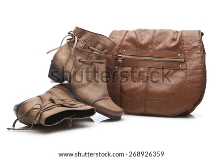 Pair of female shoes and handbag over white - stock photo