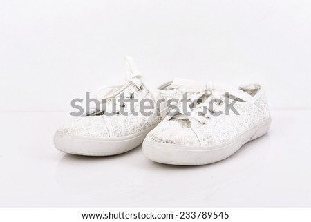 Pair of female white linen with lace womens sneakers - stock photo