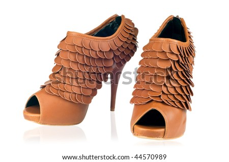 Pair of funky brown stiletto boots - stock photo