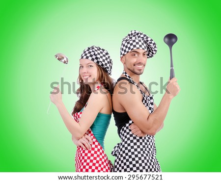 Pair of funny cooks against gradient  - stock photo