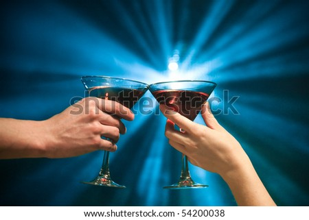 pair of glasses making a toast - stock photo
