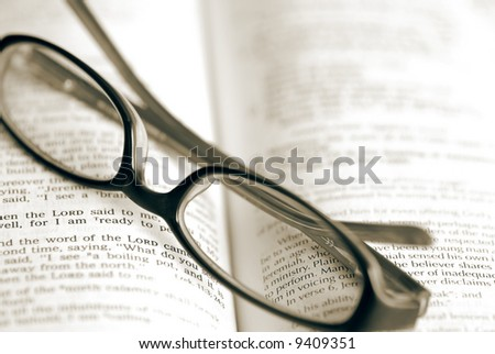 Pair of glasses on top of a Bible