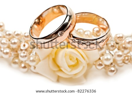 Pair of golden wedding rings. Isolated on white background - stock photo