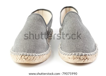pair of gray men sneakers isolated on white background - stock photo