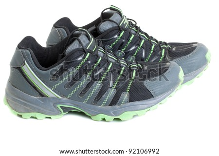 Pair of gray trainers, isolated on a white background - stock photo