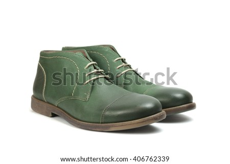 pair of green men's boots on white