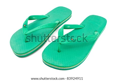 Pair of green rubber flip flop sandals isolated on white - stock photo