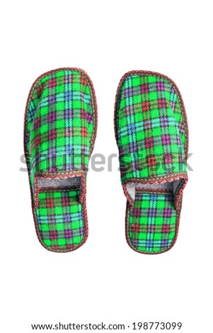 Pair of  green textile slippers isolated over white