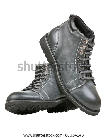 Pair of grey ankle-high men boots isolated over white - stock photo