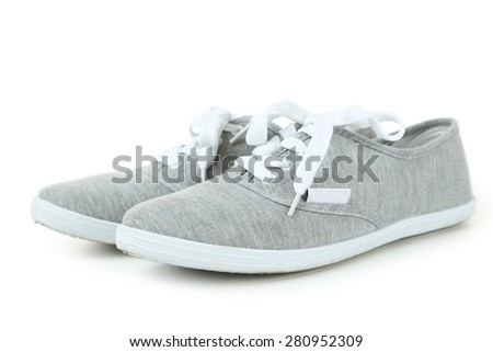 Pair of grey shoes isolated on white