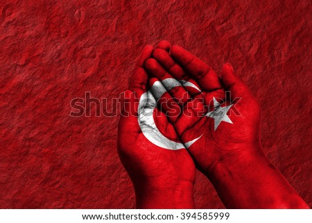 Pair of hand pray digitally compositing on with Turkey flag - stock photo