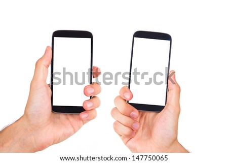 Pair of hands holding and showing mobile phones with blank, white screen, front view, isolated on white background. - stock photo