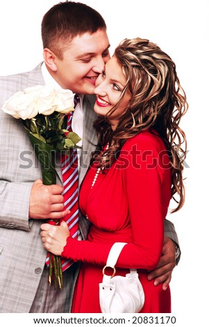 Pair of happy young people with flowers
