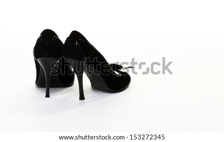 Pair of high-heeled black shoes isolated on white background - copyspace - stock photo