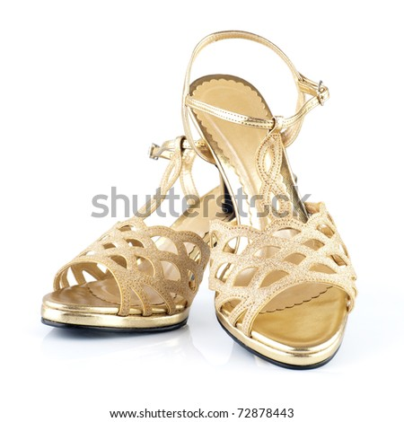 Pair of high heels golden female shoes isolated on white background - stock photo