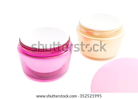 pair of jars of cream on white background