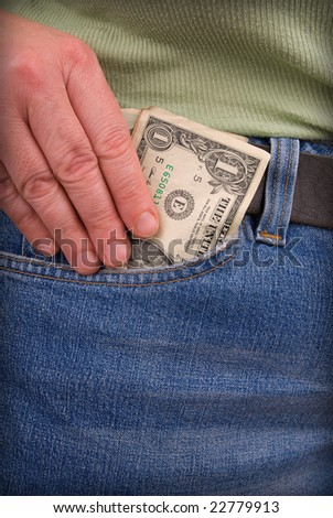 pair of jeans with a woman's hand holding Money - stock photo