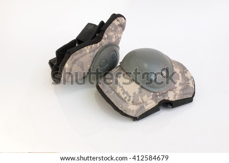 Pair of knee protectors isolated on a white background - stock photo