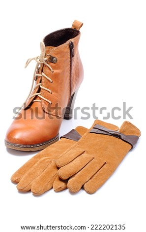 Pair of leather suede gloves for woman and leather womanly shoes isolated on white background - stock photo