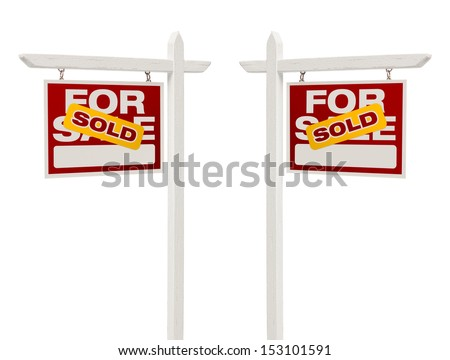 Pair of Left and Right Facing Sold For Sale Real Estate Signs With Clipping Path Isolated on White. - stock photo