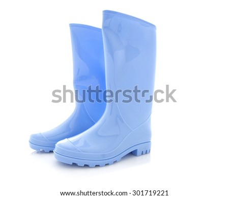 Pair Of Light Blue Wellington Boots on a White Background - stock photo