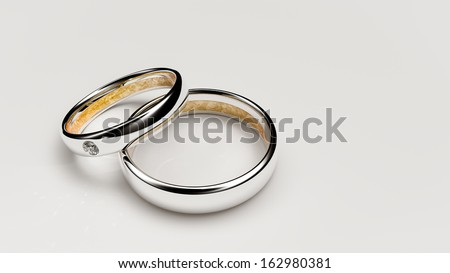 Pair of lovers wedding rings with a small diamond