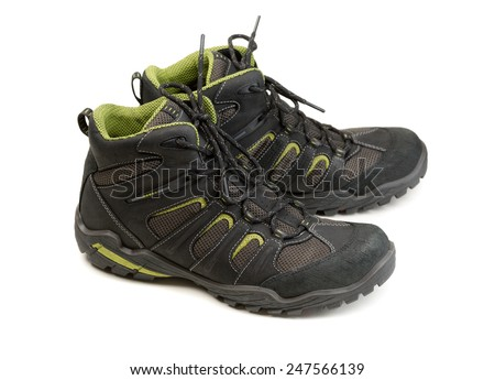 Pair of modern high-tech winter trekking shoes. Isolate on white. - stock photo
