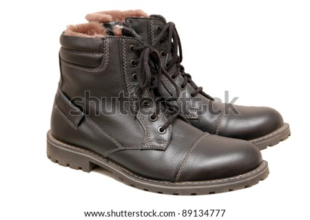 Pair of new black working boots with fur inside, Isolated on a white background
