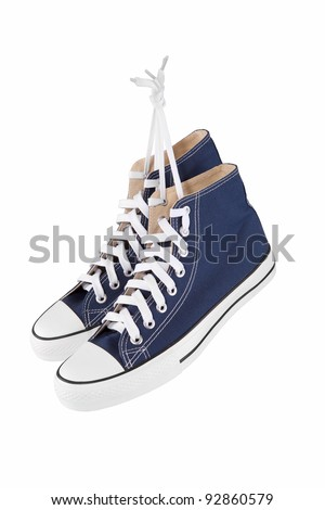 Pair of new blue sneakers isolated on white - stock photo