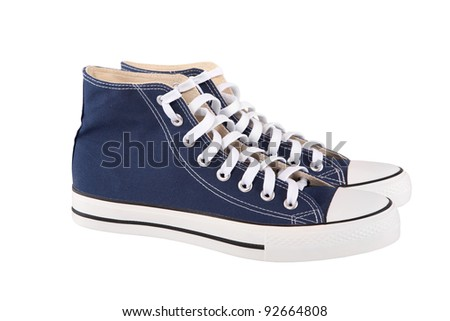 Pair of new blue sneakers on white background