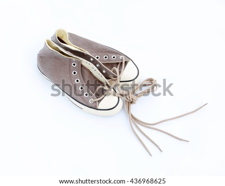 Pair of new brown sneakers isolated on white background
