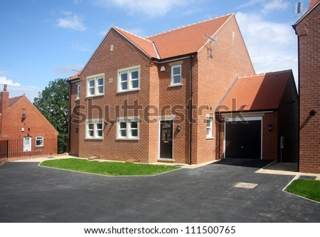 pair of new smi detached houses in Yorkshire showing driveway and entrance